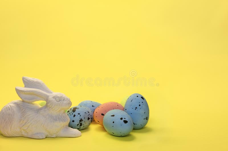 Colorful easter eggs painted in pastel colors and white rabbit hare toy royalty free stock image