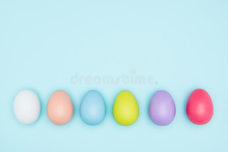 Colorful easter eggs on pastel background royalty free stock image