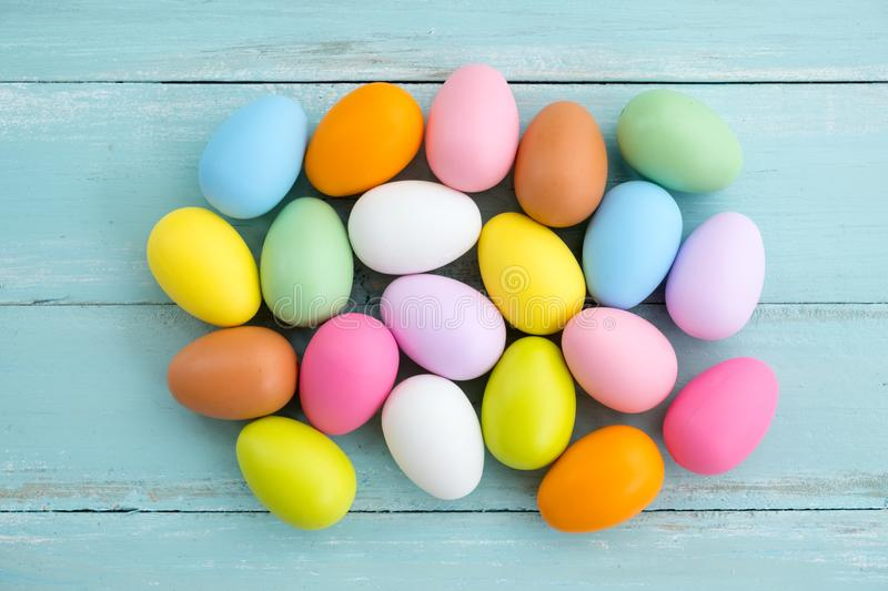 Colorful Easter eggs on rustic wooden planks background. Holiday in spring season. vintage pastel color tone. top view composition stock image