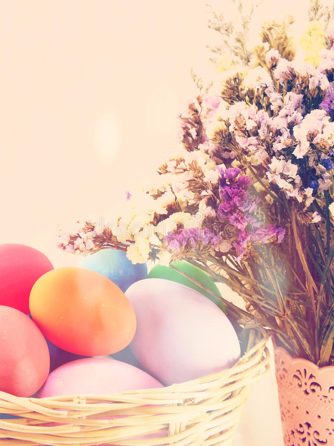 Colorful easter eggs with spring flowers background vintage filter color. Colorful easter eggs with spring flowers background vintage filter stock image