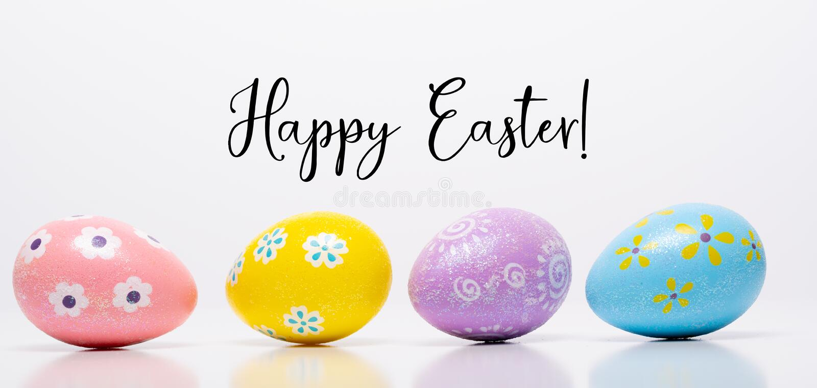 Colorful Easter eggs on white background with greeting royalty free stock images