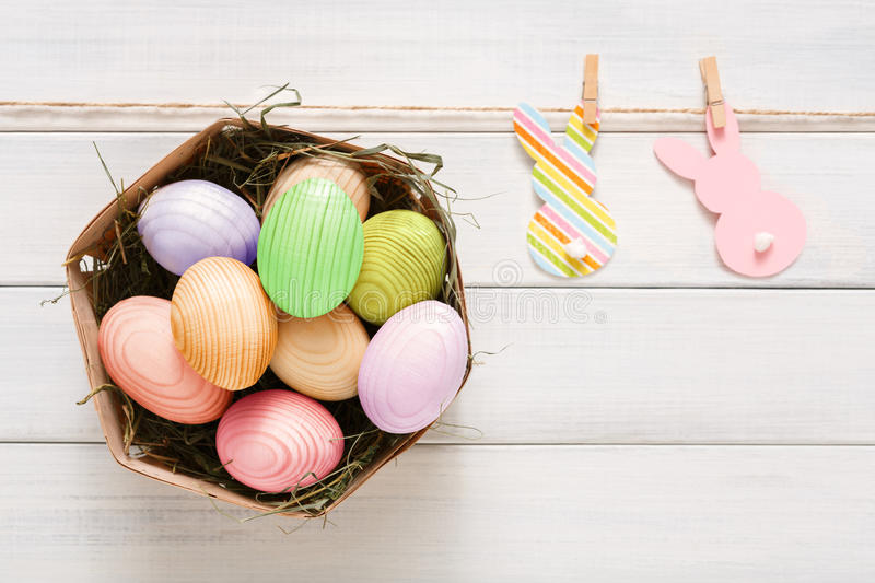 Colorful easter eggs on white wood background stock photography