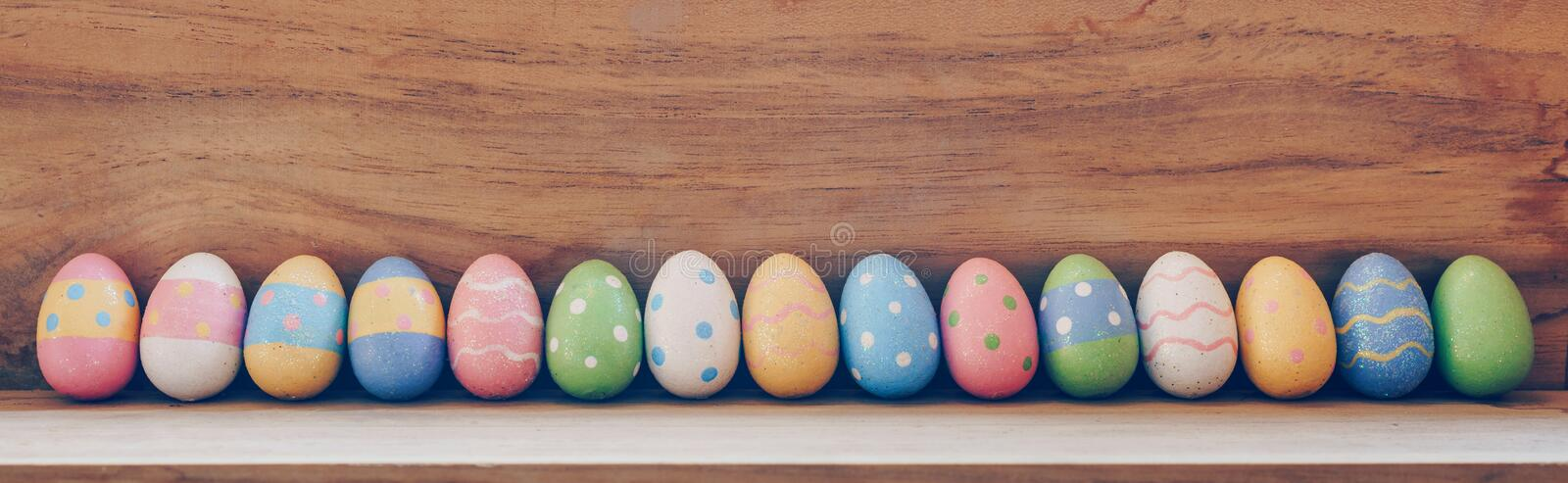 Colorful easter eggs on wooden background with copy space stock photo