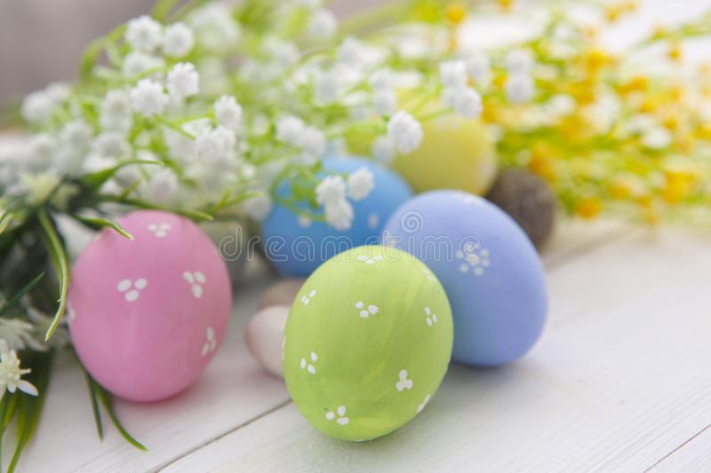 Colorful Easter eggs on wooden background. stock image