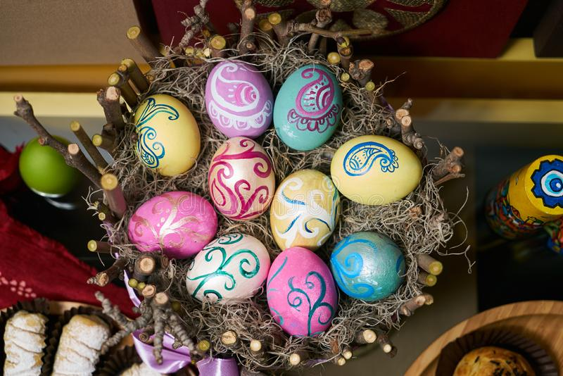 Colorful Easter eggs in a wooden nest decoration background stock photography