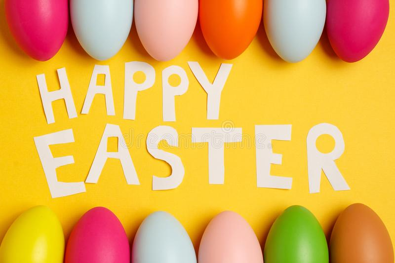 Colorful Easter eggs on a yellow background royalty free stock photography