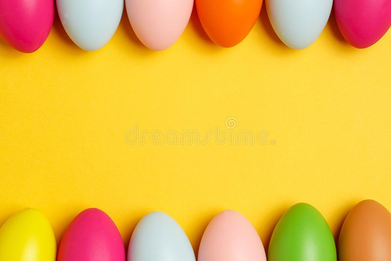 Colorful Easter eggs on a yellow background royalty free stock image