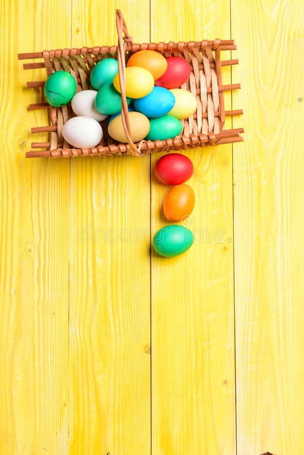 Colorful eggs in basket. Healthy and happy holiday. Spring holiday. Holiday celebration, preparation. Happy easter stock photography