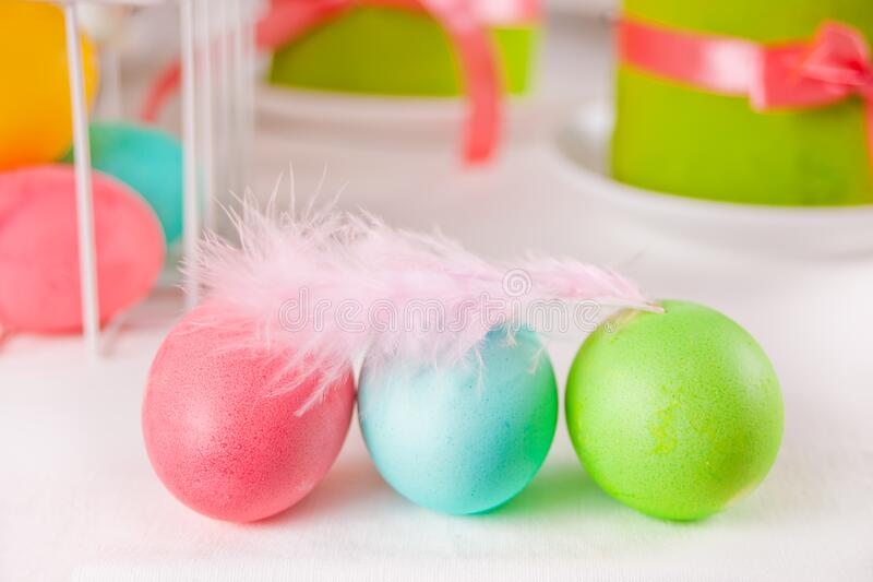 Colorful Eggs For Easter Day With Feather Gift Box And Small Cake