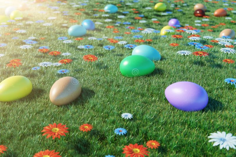 Colorful eggs in a meadow on a sunny day, with beautiful flowers. Multicolored painted easter eggs on grass, lawn royalty free stock image