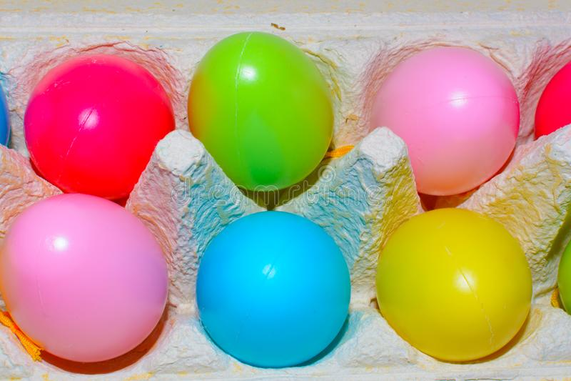 Colorful eggs in rainbow colors in a tray stock photo