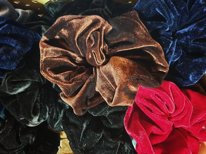 Colorful elastic rings. Girl elastic fashion band. hair scrunchy. A scrunchie is a fabric covered rubber band hair used to fasten royalty free stock photography