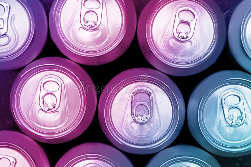 Colorful energy soda drinks cans overhead. View stock photography