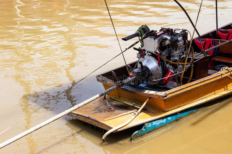 Colorful engine on a longtail boat of amphawa floating market is the tourist most popular in Samut Songkhram, thailand.  royalty free stock photos