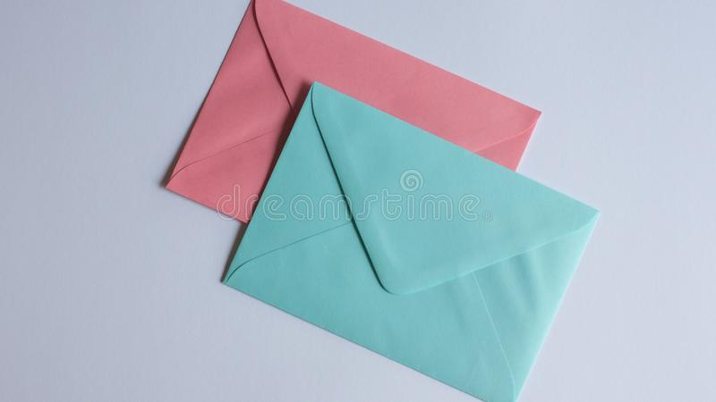 Colorful envelopes on white stock image