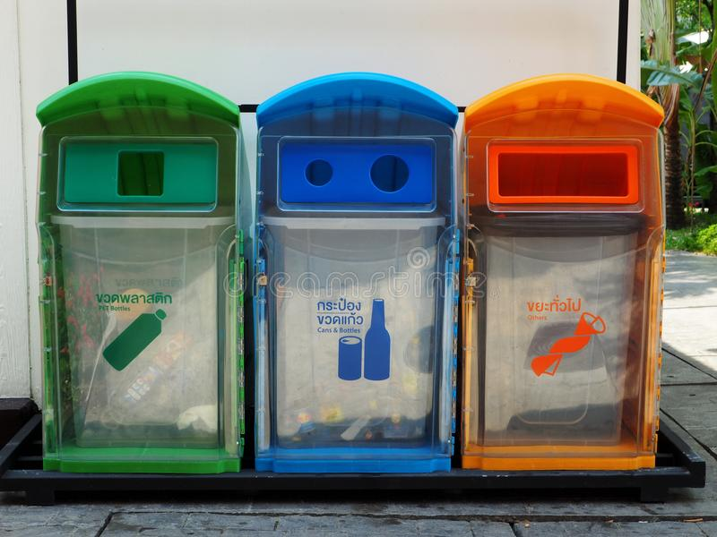 Colorful and environment-friendly transparent outdoor waste bins stock photography