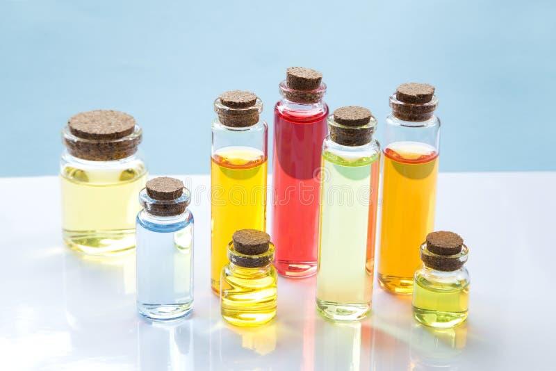 Essence oil bottles stock photo