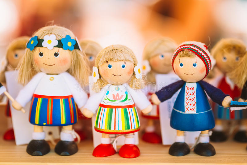 Colorful Estonian Wooden Dolls At The Market. Dolls Are The Most Popular Souvenirs From Tallinn And Symbol Of Country's Culture royalty free stock photo