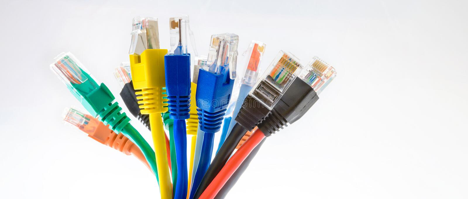 Colorful ethernet patch cords with RJ-45 connectors. In a bunch on the white background stock image
