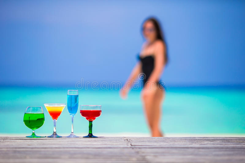 Colorful exotic tasty cocktails in outdoor cafe royalty free stock image
