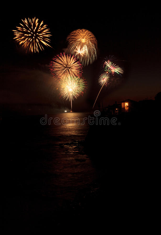 Colorful explosion of fireworks over the Emerald Bay beach royalty free stock images