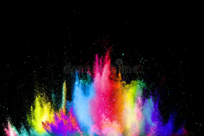 Colorful explosion for Happy Holi powder.Abstract background of color particles burst or splashing stock photos