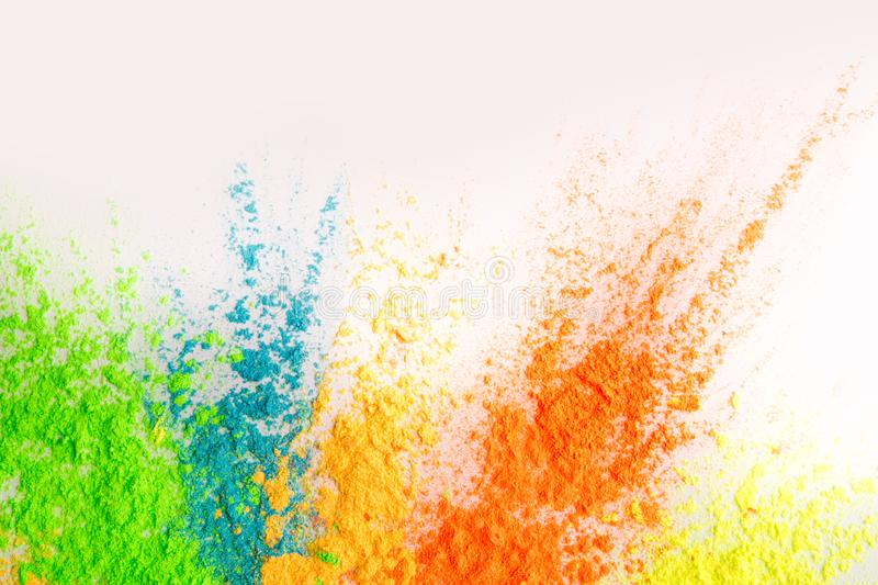 Colorful explosion of holi dust on white background. Spring Indian festval. Colorful explosion of holi dust on white background, copy space royalty free stock image