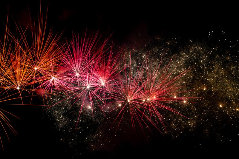 Fireworks over black sky stock photography