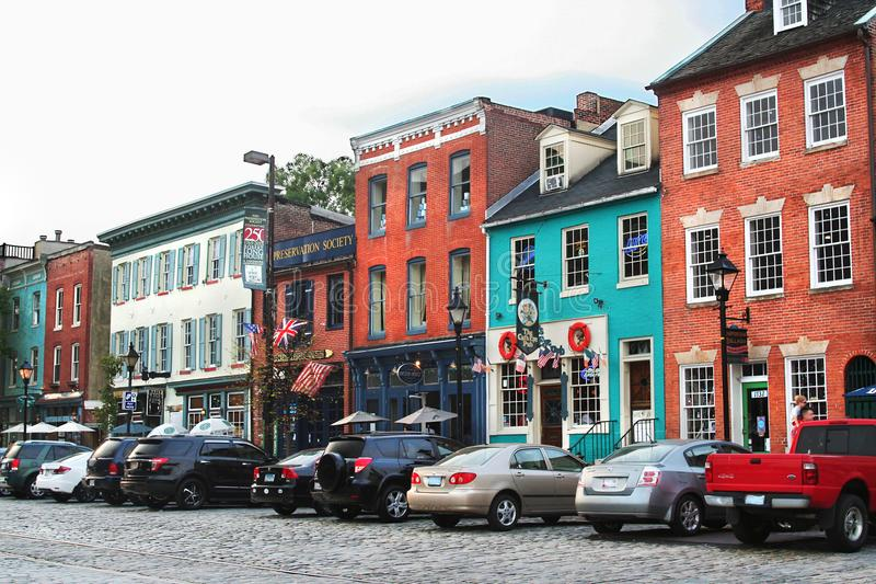 Historic buildings line cobblestone streets in Fells Point, Baltimore MD stock photography