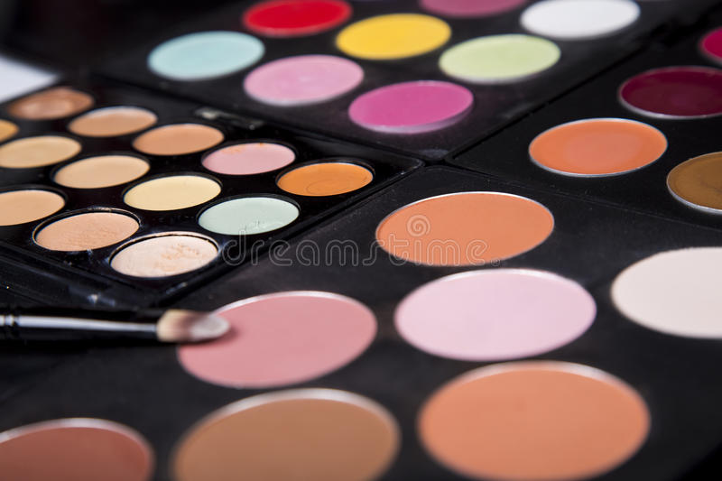 Colorful eyeshadow palette and blush for make-up closeup. Colorful eyeshadow palette and blush for make-up stock images