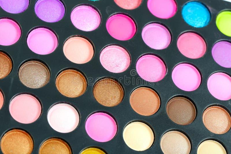 Colorful eyeshadow palette. Decorative colorful eyeshadow set , close up shot stock photo