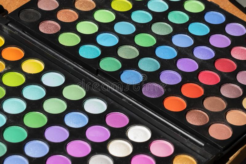 Colorful eyeshadow palette. Makeup background. Makeup texture. Horizontal royalty free stock photo