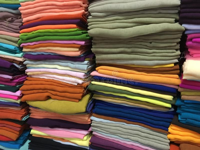 Colorful fabric cotton rolls lined up for the fashion collection,Concept: Clothing product industry for the shop in the market,. Colorful fabric cotton rolls stock photo
