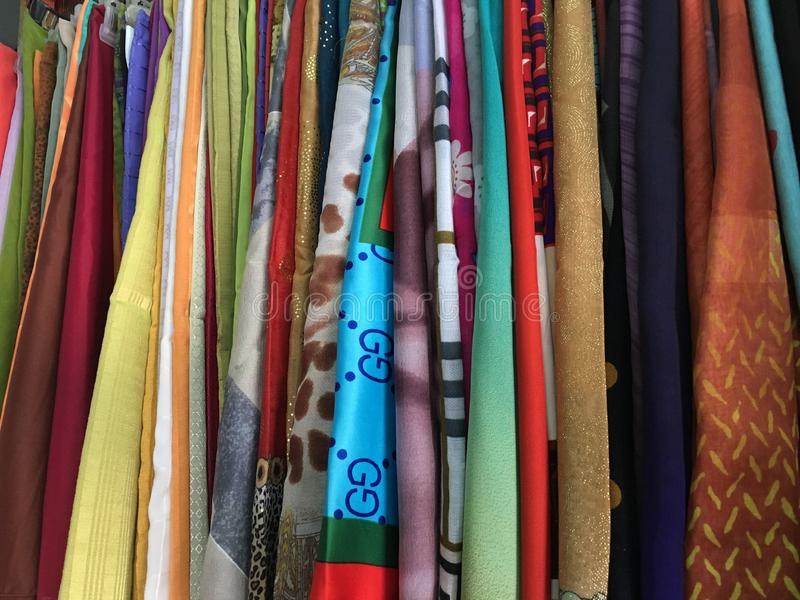 Colorful fabric cotton rolls lined up for the fashion collection,Concept: Clothing product industry for the shop in the market,. Colorful fabric cotton rolls royalty free stock images