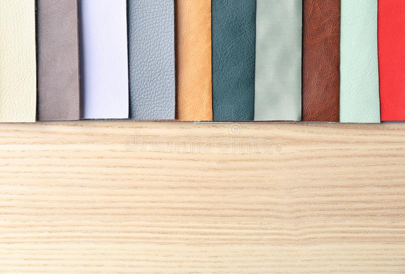 Colorful fabric samples. On wooden background stock photography