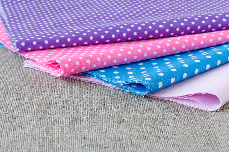 Colorful fabric samples on wooden table royalty free stock images