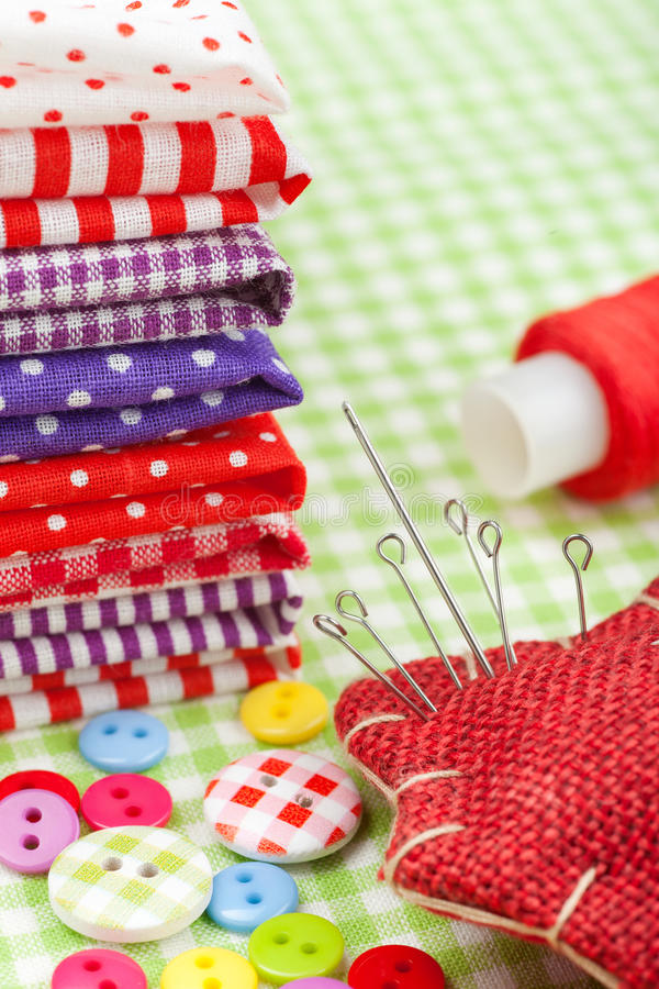 Download Colorful Fabrics, Buttons, Pin Cushion, Thimble, Spool Of Thread - Set For Sewing Stock Photo - Image: 28814804