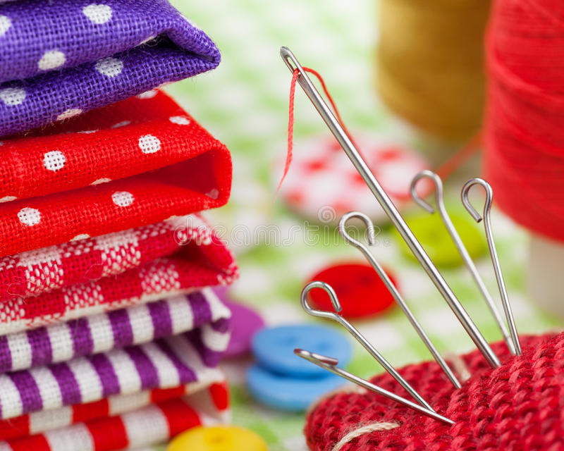 Download Colorful Fabrics, Buttons, Pin Cushion, Thimble, Spools Of Thread For Sewing Stock Photo - Image: 28814766