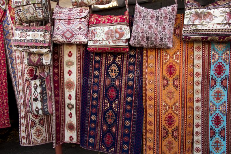 Colorful fabrics and other folk products at a roadside stall wit stock image