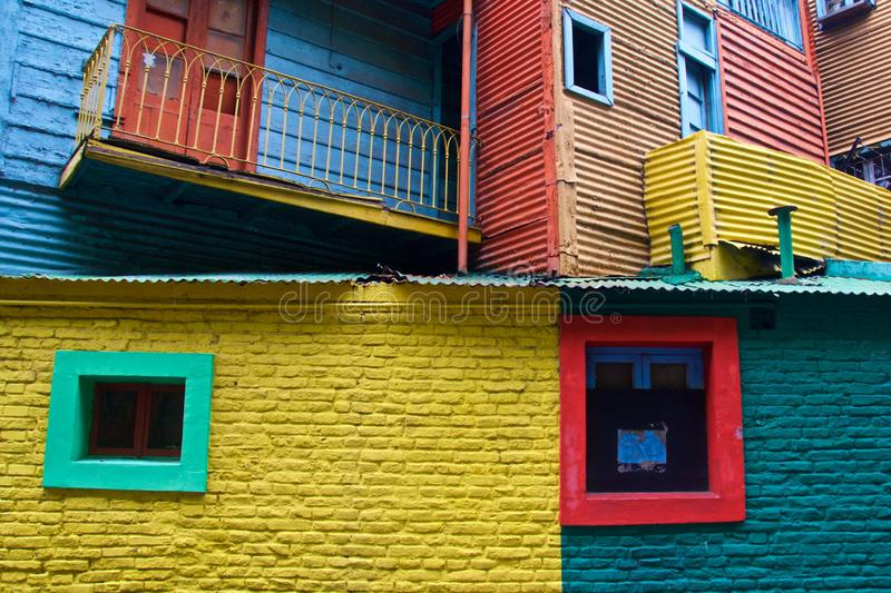 Colorful facade of houses in a bright little alley in La Boca, a part of tango history. Colorful facade of houses in a bright little alley in La Boca, a part of stock photos