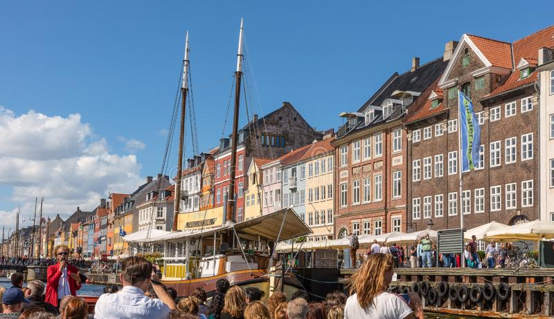 Colorful facade and old ship along the Nyhavn or New Harbor, Copenhagen stock image