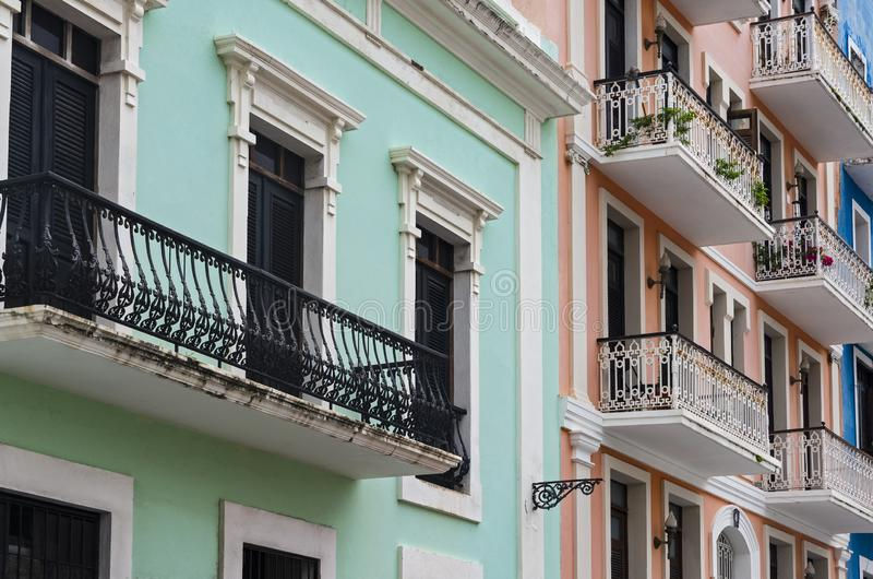 Colorful Facades and Balconies of Old San Juan. Colorful facades of colonial architecture preserved in historic old san juan puerto rico royalty free stock image