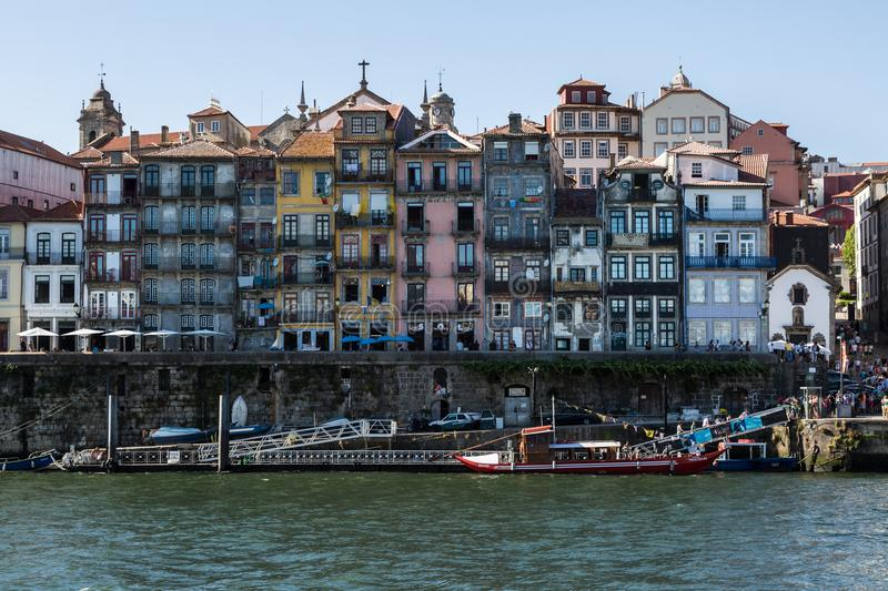 Colorful Facades of Typical Houses on the Bank of the River Dour. Old Town Skyline from Across the Douro River: Typical Colorful Facades - Porto, Portugal royalty free stock photography