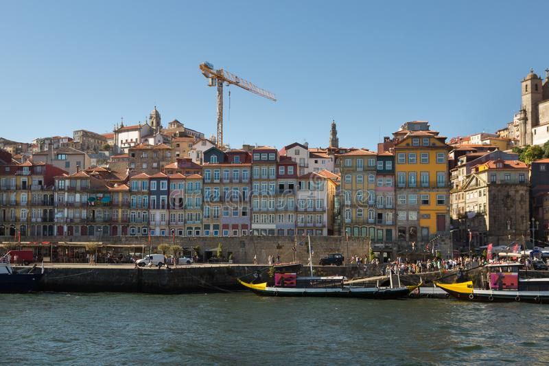 Colorful Facades of Typical Houses on the Bank of the River Dour. Old Town Skyline from Across the Douro River: Typical Colorful Facades and Rabelo Boats - Porto stock images