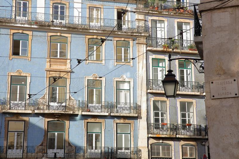 Colorful facades with wrought iron railing balconies in Alfama neighborhood, Lisbon, Portugal. Colorful facades with wrought iron railing balconies in Alfama royalty free stock photography