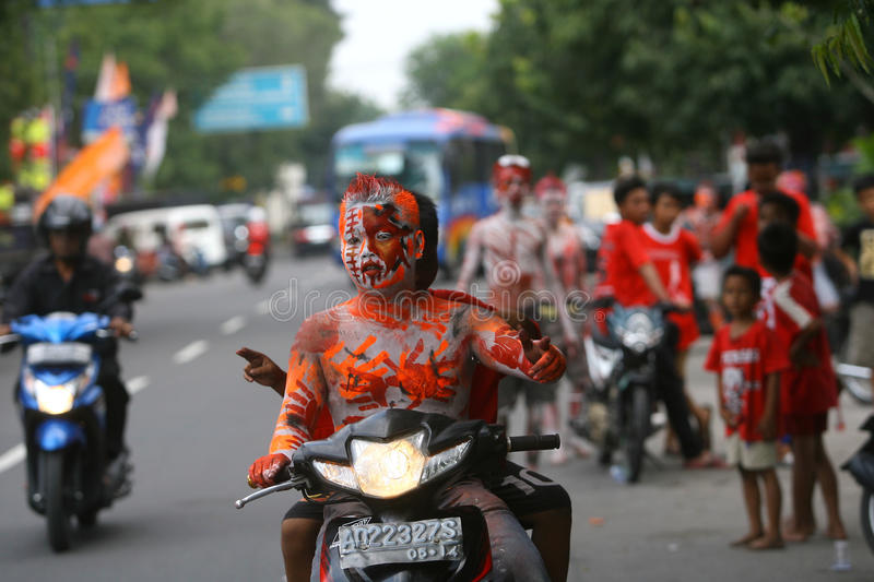 The Colorful Face of Joko Widodo Supporter. Joko Widodo supporters paint their faces with the colors of the current campaign in Surakarta, Central Java stock images