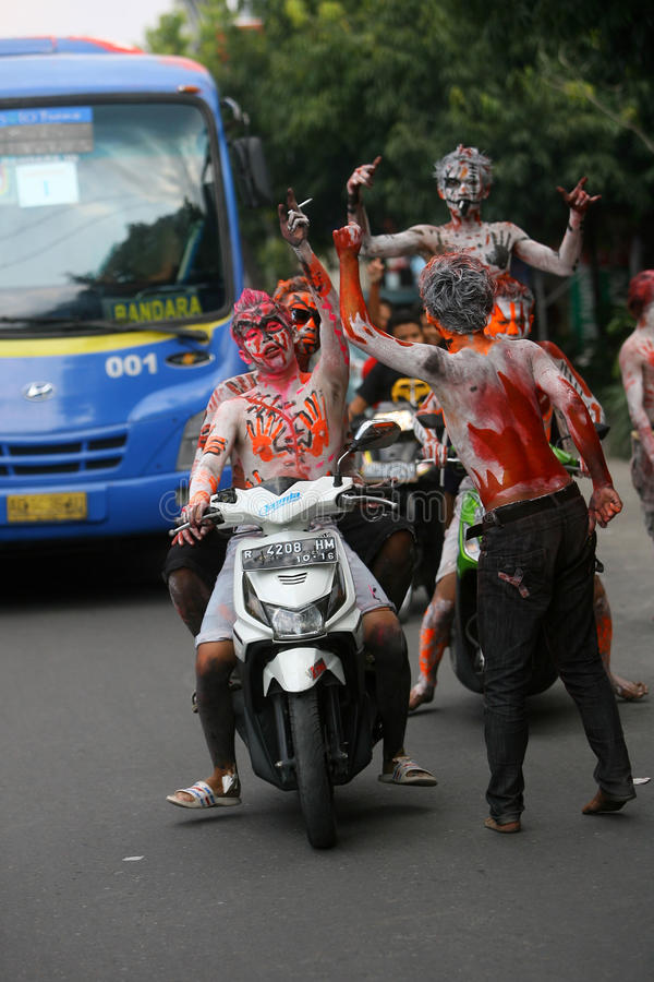 The Colorful Face of Joko Widodo Supporter. Joko Widodo supporters paint their faces with the colors of the current campaign in Surakarta, Central Java royalty free stock image