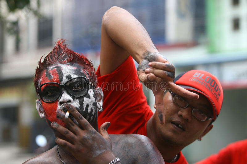 The Colorful Face of Joko Widodo Supporter. Joko Widodo supporters paint their faces with the colors of the current campaign in Surakarta, Central Java stock image