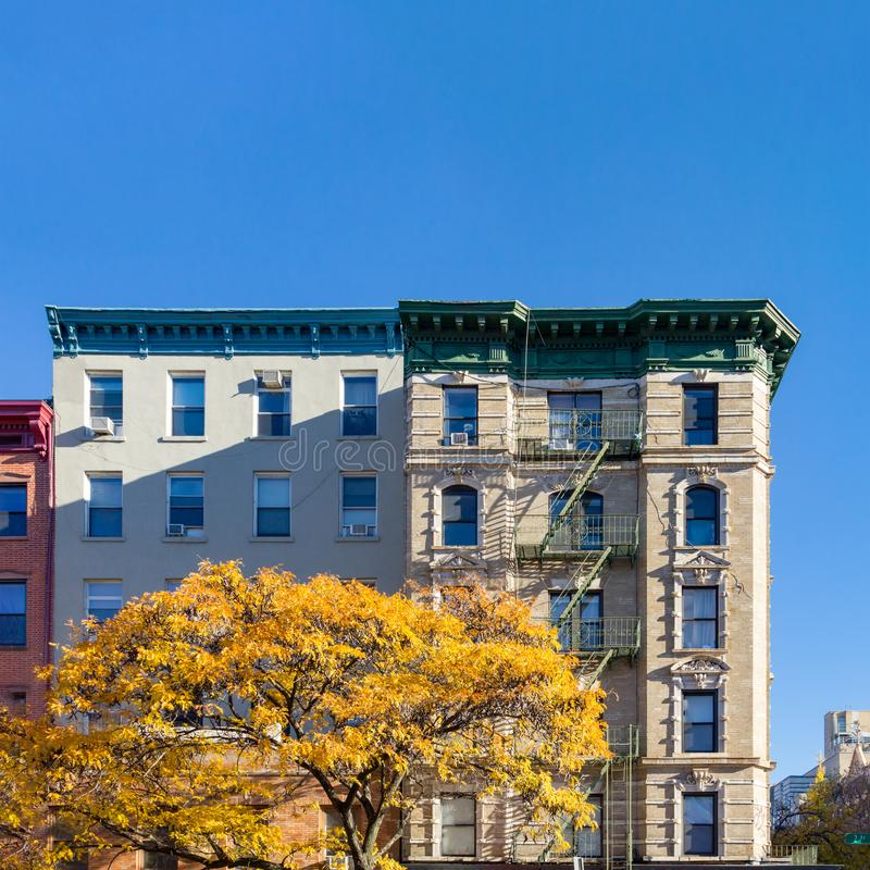 New York City Apartment Buildings: Colorful Apartment Building In NY With Red Fire Escapes