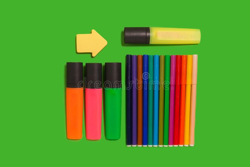 Colorful felt pens, markers, watercolour paints and stickers royalty free stock photo
